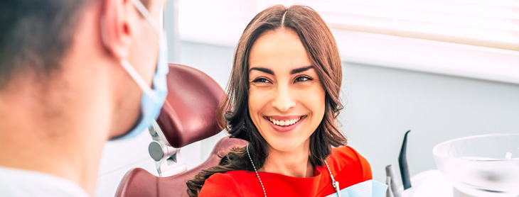 Woman smiling up at her dentist